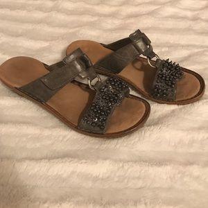 Dark gray, embellished rieker sandals.